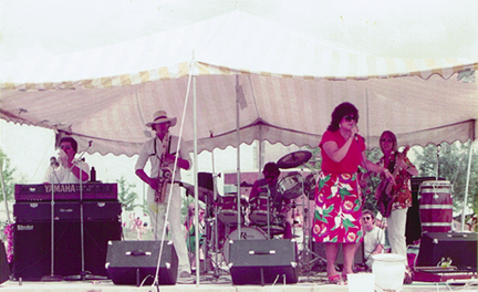 Roy Rendahl playing bass with The Barb Timm Band for an outdoor festival in Winona, Minnesota in 1983